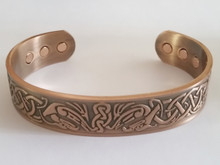 The Celtic Bird copper bracelet for men has a beautiful embossed celtic design