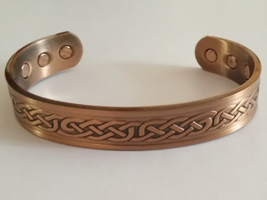 The celtic knot magnetic copper bracelet is embossed with the celtic knot symbol referred to as the mystic knot or endless knot.