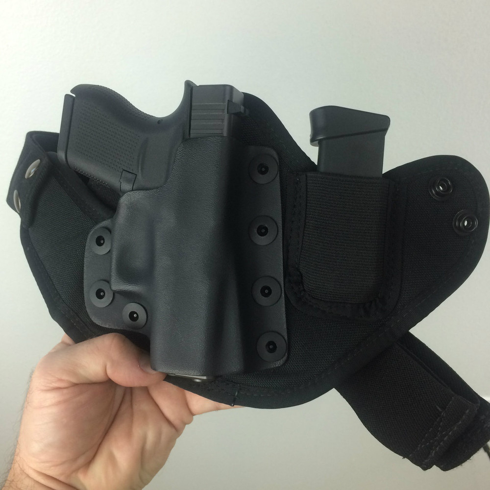 The Combat Appendix Carry IWB Holster pictured with the Glock 43 comes stock with an extra magazine carrier. The mag carrier collapses when not in use for greater concealment.