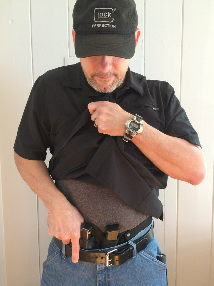 Combat Appendix Carry Holster pictured with the Glock 19 and full size Glock 17 extra magazine.