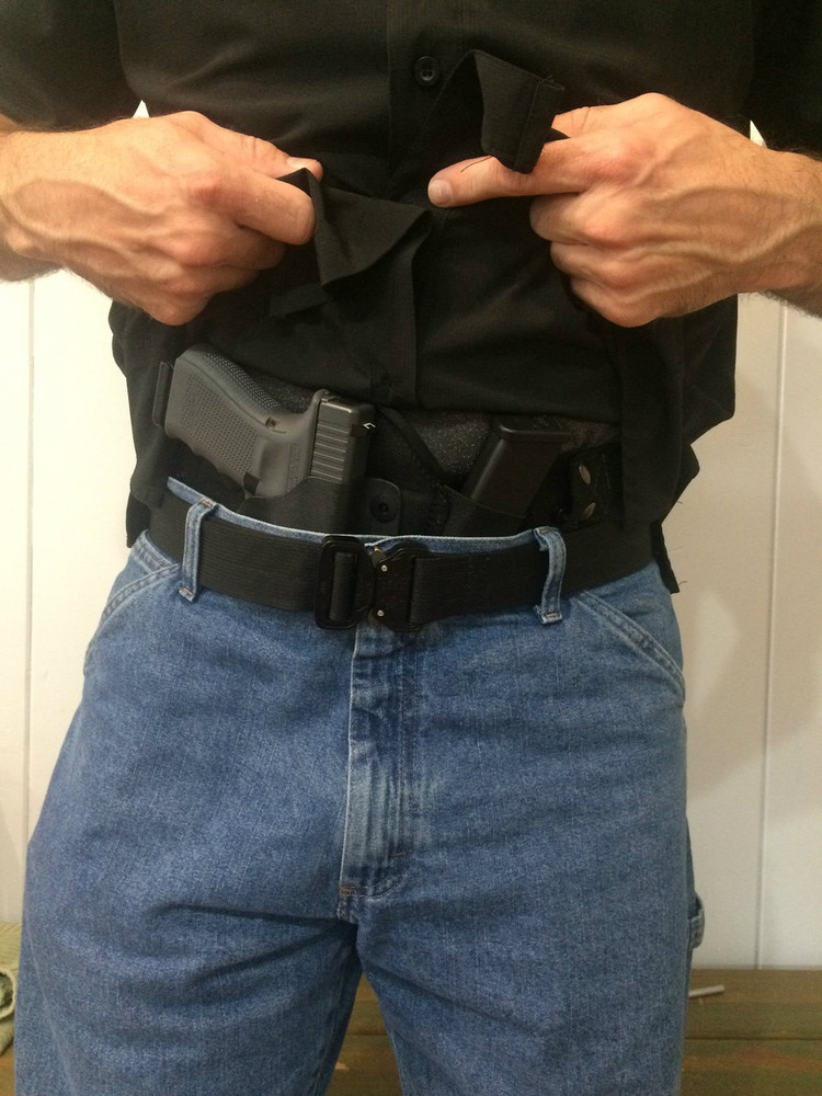 Appendix Carry IWB Holster pictured with the Glock 19 and full size Glock 17 extra magazine.