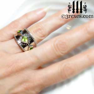 3-wishes-silver-medieval-wedding-ring-gothic-green-peridot-stones-wide-studded-band-model-hand