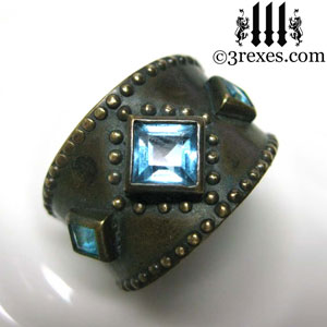 brass-3-wishes-ring-front-blue-topaz-stone-medieval-gothic-wedding-jewelry-december-birthstone