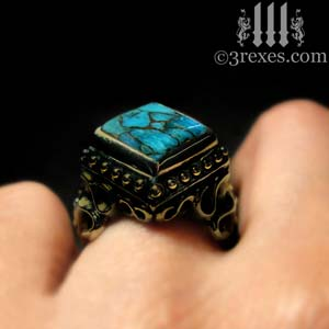 brass-raven-love-ring-blue-topaz-cocktail-ring-on-medieval-model