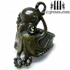 octopus dream ring dark brass patina green peridot cabochon stone eyes gothic studded steampunk band