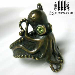 octopus ring dark brass patina green peridot stone eyes goth studded band side detail