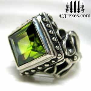 womens-raven-love-silver-wedding-ring-gothic-green-peridot-stone-medieval-engagement-band-side-view-august-birthstone-jewelry