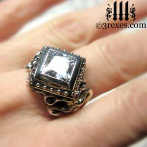raven-love-silver-wedding-ring-gothic-white-cz-stone-medieval-band-model wearing a large cocktail statement promise ring