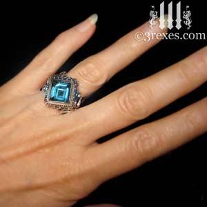 raven-love-wedding-ring-blue-topaz-stone-model-detail december birthstone