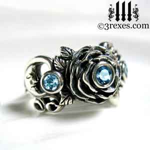 silver moon ring, silver rose ring, silver flower ring, with moon detail and blue topaz stones december birthstone by 3 rexes jewelry