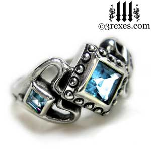 womans-silver-princess-love-ring-blue-topaz-stone-side-detail.jpg