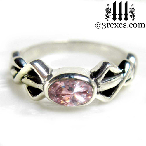 silver friendship ring with pink cz stone