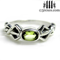 silver friendship ring with green peridot stone