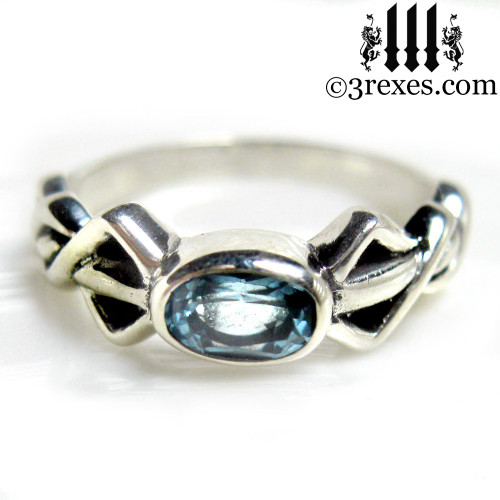 silver friendship ring with blue topaz stone