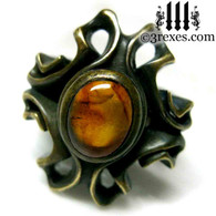 empress vampire brass ring with amber cabochon