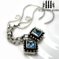 royal jeweled charm earrings .925 sterling silver with blue topaz stones