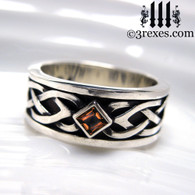 mens celtic knot silver soul ring with light red garnet stone