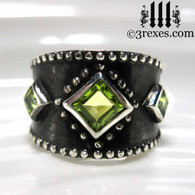 silver medieval ring with celtic green peridot (dark antiquing)