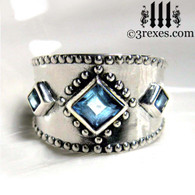 silver medieval ring with blue topaz