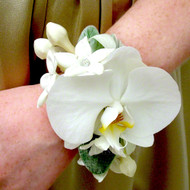 White Phalaenopsis orchid wrist corsage with crystal band.