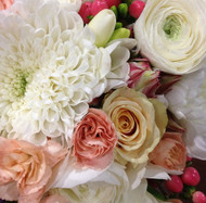 Seasonal Wedding flowers including roses: pastel apricots, creams and whites