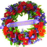 Deluxe 55cm across with LEST WE FORGET ribbon