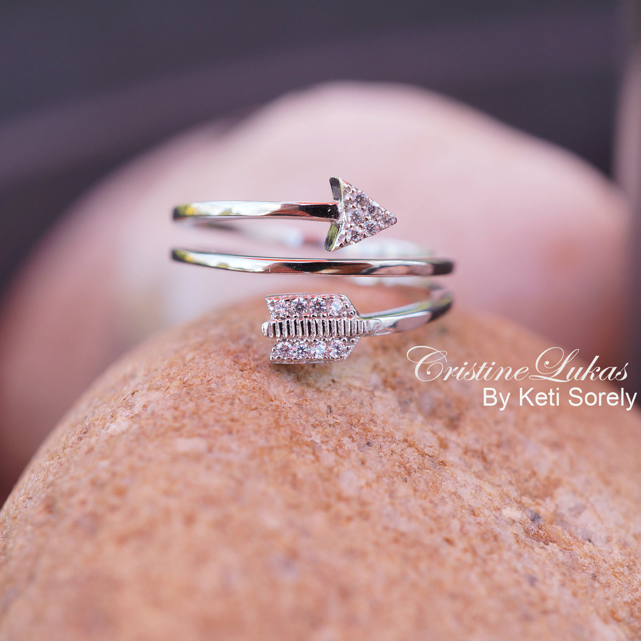 Sideways arrow ring with clear Zubic Zirconia stones. By-pass arrow ...