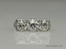 Platinum Art Deco Three Diamond Ring.