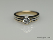14 Karat Yellow and White Gold Bezel Set Diamond Solitare Ring