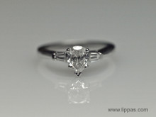 Platinum Pear Shape Diamond With Tapered Baguette Diamond Accents