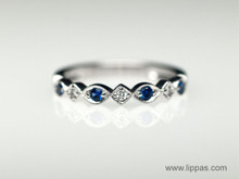 14 Karat White Gold Sapphire and Diamond Seven Stone Band