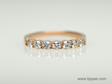 14 Karat Rose Gold Seven Diamond Band