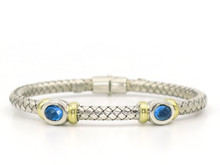 Silver and 18 Karat Yellow Gold Weave Bracelet with Bezel Set Topaz