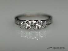 18 Karat White Gold Three Stone Round Brilliant Cut Diamond Engraved Shank Engagement Ring