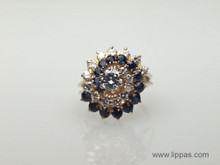 18 Karat Yellow Gold Diamond and Sapphire Swirl Ring
