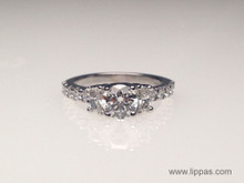 Custom Made Engagement Ring with Center Round Diamond with Trapezoid Side Diamonds and
