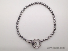14 Karat White Gold Diamond Bracelet with a Diamond Circle Clasp