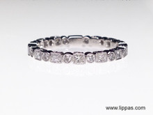 14 Karat White Gold Diamond Band with Alternating Princess and Round Brilliant Cut Diamonds