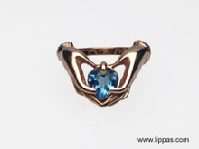 14 Karat Yellow Gold Claddagh Ring with Blue Topaz and Diamond