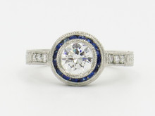 Platinum Diamond Engagement Ring with a Sapphire Halo