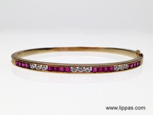 14 Karat Yellow Gold Ruby and Diamond Hinged Bangle Bracelet