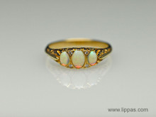 18 Karat Yellow Gold Opal and Diamond ring