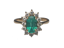 14 Karat Yellow Gold Emerald Ring with Diamond Halo