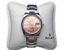 Stainless Steel Rolex Date with 18 Karat White Gold Bezel and Salmon Diamond Dial Watch