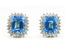 14 Karat White Gold Blue Topaz and Diamond Halo Earrings