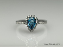 14 Karat White Gold Pear Shape Blue Topaz and Diamond Ring