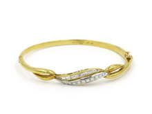 18 Karat Yellow Gold Diamond Wave Bangle