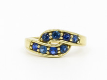 14 Karat Yellow Gold and Sapphire Twist Band