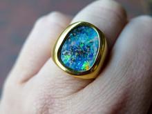 18 Karat Yellow Gold Oval Shaped Bezel Set Opal Ring