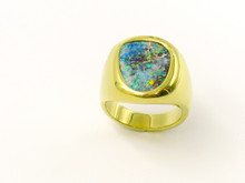 18 Karat Yellow Gold Oval Shaped Bezel Set Opal Ring